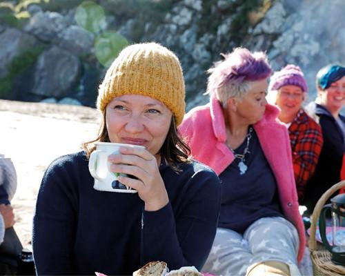 Woman drinking tea at a picnic