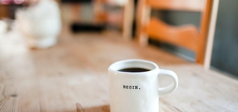 Mug with begin written on it