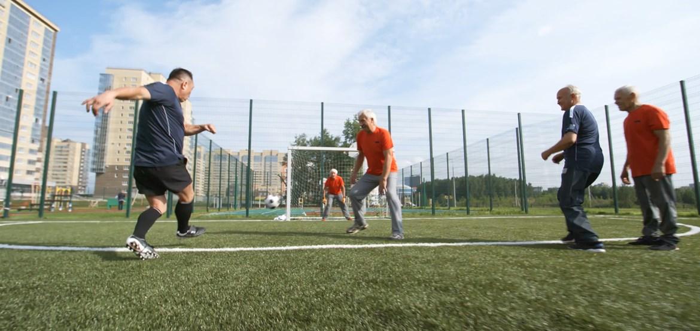 Mid life men playing football