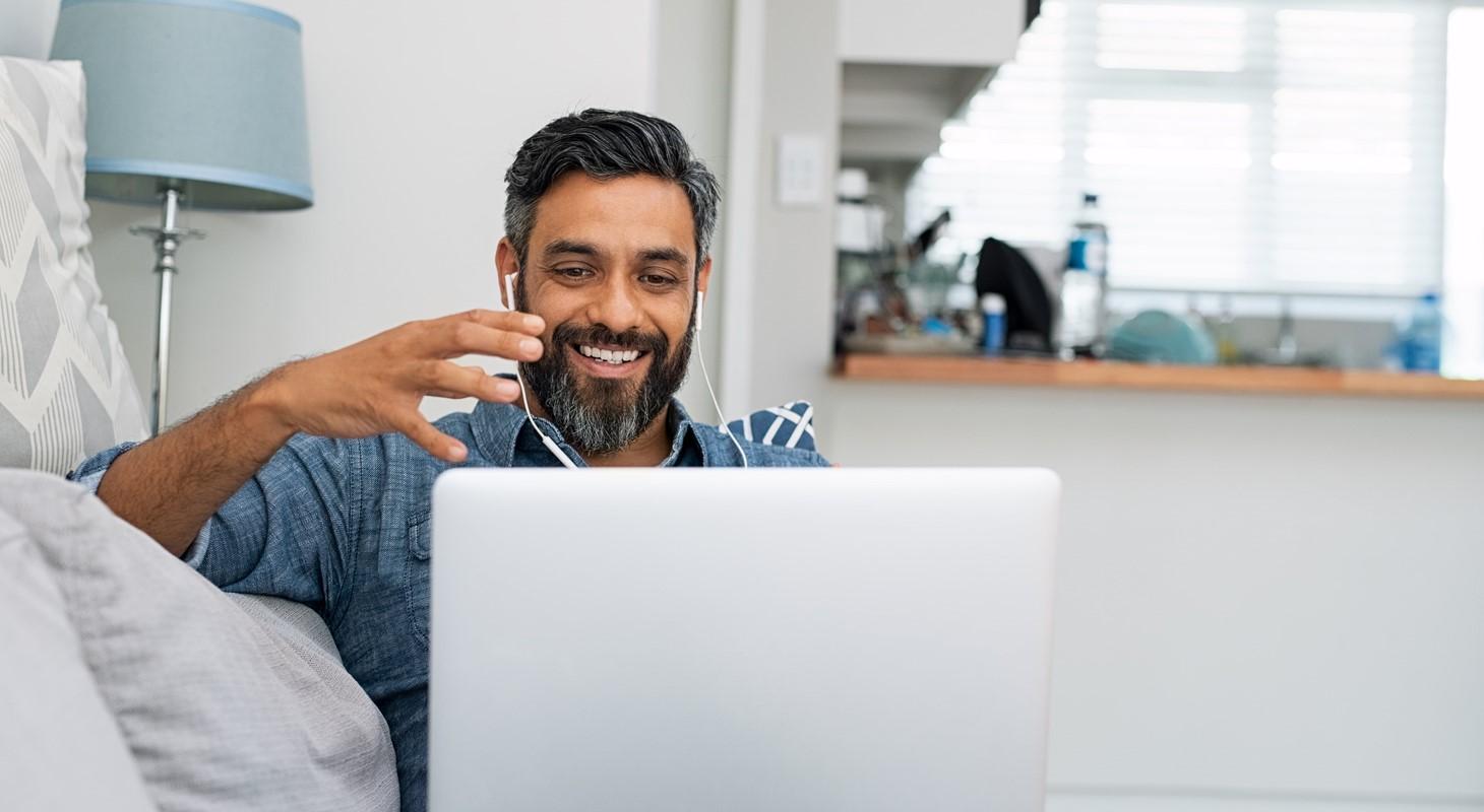Man on laptop with headphones
